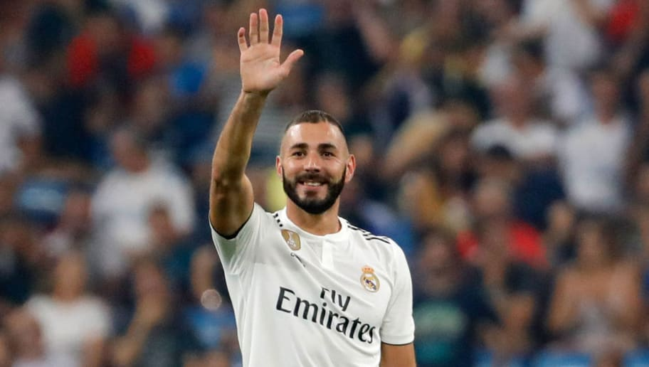 MADRID, SPAIN - SEPTEMBER 01: Tor zum 2, 1 Torschuetze Karim Benema of Real Madrid  celebrates after scoring his team`s second goal with team mates  during the La Liga match between Real Madrid CF and CD Leganes at Estadio Santiago Bernabeu on September 1, 2018 in Madrid, Spain.
