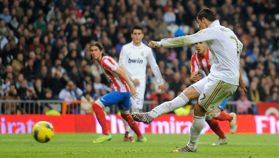 MADRID, SPAIN - NOVEMBER 26:  Cristiano Ronaldo of Real Madrid scores his sides 4th goal from the penalty spot during the La Liga match between Real Madrid and Atletico Madrid at Estadio Santiago Bernabeu on November 26, 2011 in Madrid, Spain.  (Photo by Denis Doyle/Getty Images)