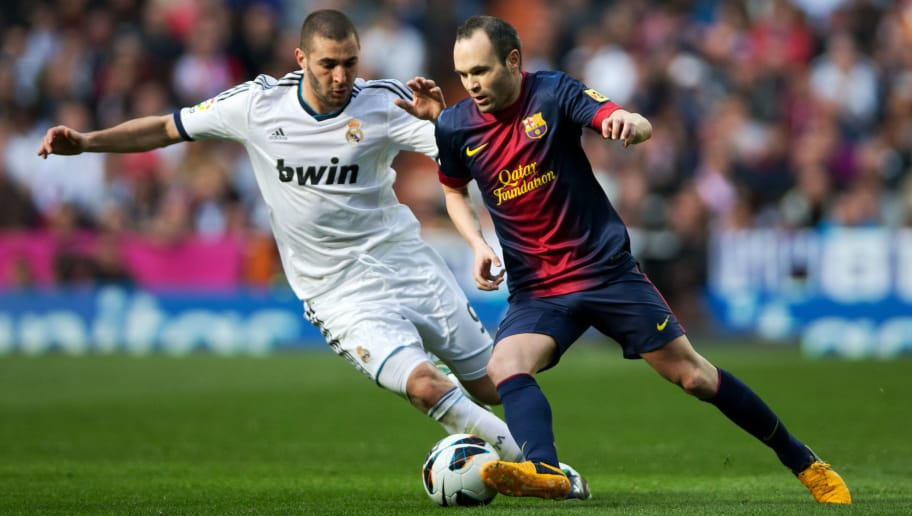 MADRID, SPAIN - MARCH 02: Andres Iniesta (R) of Barcelona duels for the ball with Karim Benzema of Real Madrid during the la Liga match between Real Madrid CF and FC Barcelona at Estadio Santiago Bernabeu on March 2, 2013 in Madrid, Spain.  (Photo by Jasper Juinen/Getty Images)