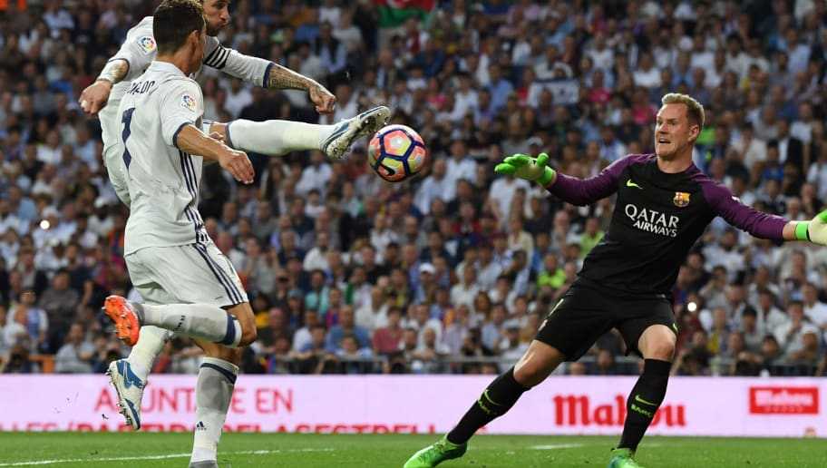 MADRID, SPAIN - APRIL 23:  Sergio Ramos of Real Madrid (L) hits the post for Casemiro of Real Madrid (not pictured) to follow up and score the first goal during the La Liga match between Real Madrid CF and FC Barcelona at Estadio Bernabeu on April 23, 2017 in Madrid, Spain.  (Photo by David Ramos/Getty Images)