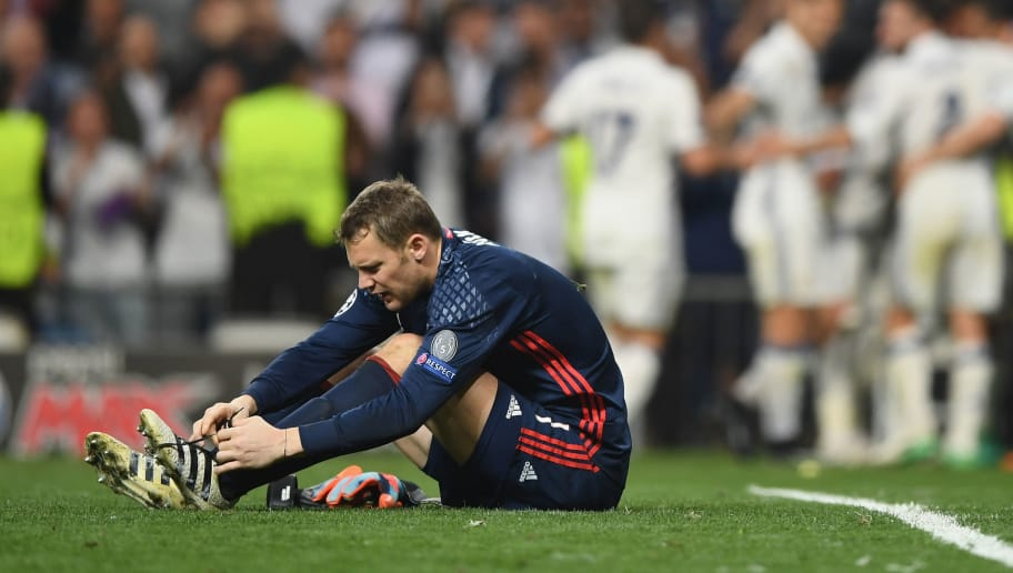 MADRID, SPAIN - APRIL 18:  Manuel Neuer of Bayern Muenchen reacts after Cristiano Ronaldo of Real Madrid (not pictured) scores his sides third goal and hatrick goal during the UEFA Champions League Quarter Final second leg match between Real Madrid CF and FC Bayern Muenchen at Estadio Santiago Bernabeu on April 18, 2017 in Madrid, Spain.  (Photo by Shaun Botterill/Getty Images)