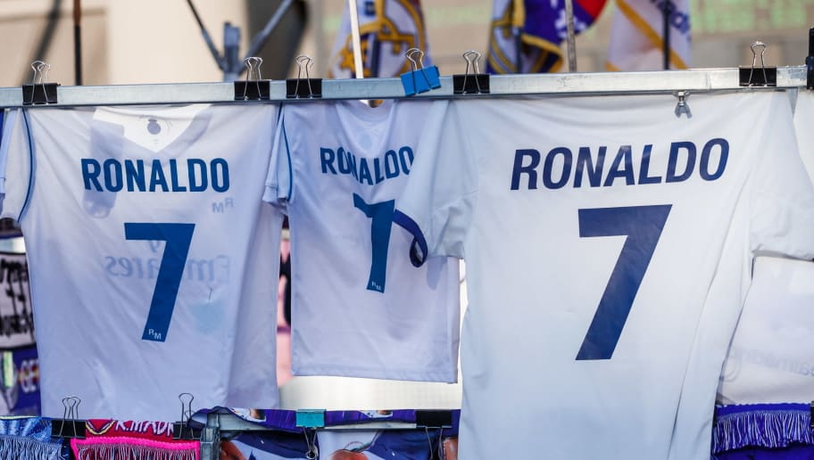 MADRID, SPAIN - AUGUST 19: Shirts of Messi and Cristiano Ronaldo are seen during the La Liga match between Real Madrid CF and Getafe CF at Estadio Santiago Bernabeu on August 19, 2018 in Madrid, Spain. (Photo by TF-Images/Getty Images)