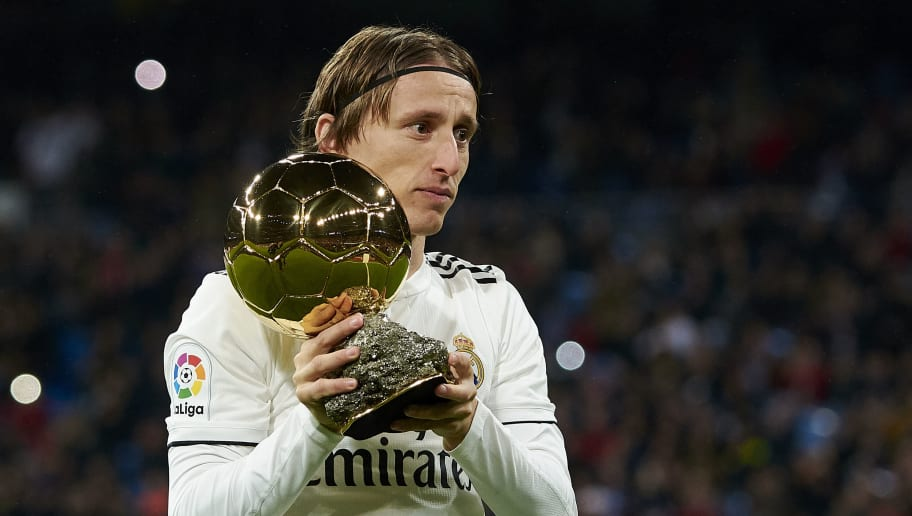MADRID, SPAIN - DECEMBER 15: Luka Modric of Real Madrid presents his Ballon d'Or Trophy prior to the La Liga match between Real Madrid CF and Rayo Vallecano de Madrid at Estadio Santiago Bernabeu on December 15, 2018 in Madrid, Spain. (Photo by Quality Sport Images/Getty Images)