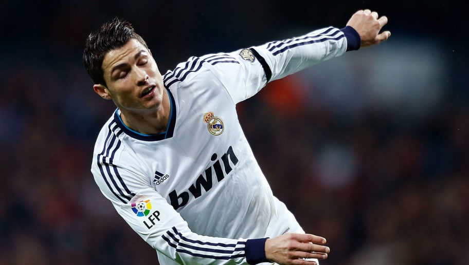 MADRID, SPAIN - DECEMBER 16:  Cristiano Ronaldo of Real Madrid CF falls during the match during the La Liga match between Real Madrid CF and RCD Espanyol at Estadio Santiago Bernabeu on December 16, 2012 in Madrid, Spain.  (Photo by Gonzalo Arroyo Moreno/Getty Images)