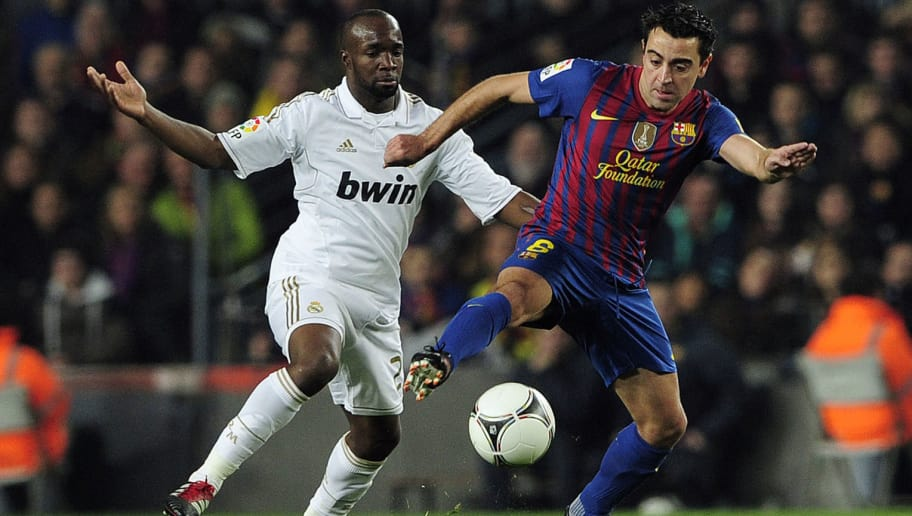 Real Madrid's French midfielder Lassana Diarra (L) vies with Barcelona's midfielder Xavi Hernandez  (R) during the second leg of the Spanish Cup quarter-final 'El clasico' football match Barcelona vs Real Madrid at the Camp Nou stadium in Barcelona on January 25, 2012. AFP PHOTO/ JOSEP LAGO (Photo credit should read JOSEP LAGO/AFP/Getty Images)