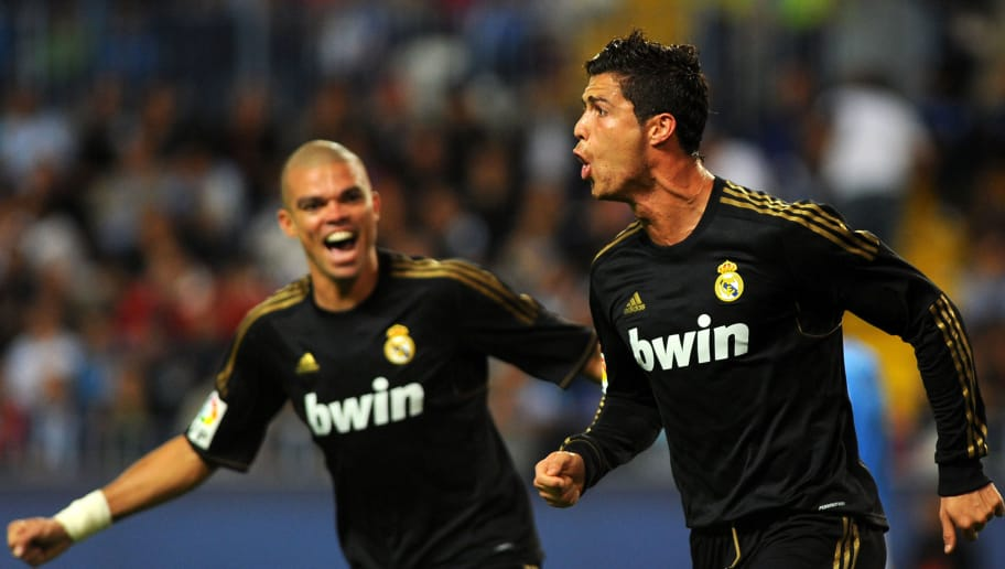 Real Madrid's Portuguese forward Cristiano Ronaldo (R) with Real Madrid's Portuguese defender Pepe (L) celebrate after scoring during the Spanish league football match Malaga CF vs Real Madrid on October 22, 2011 at Rosaleda stadium in Malaga.    AFP PHOTO/ JORGE GUERRERO (Photo credit should read Jorge Guerrero/AFP/Getty Images)