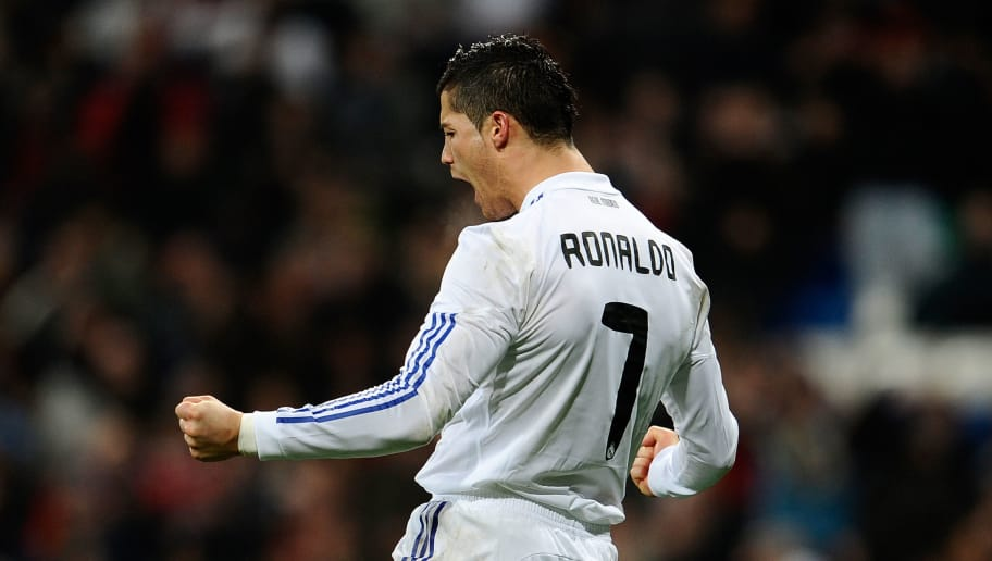 Real Madrid's Portuguese forward Cristiano Ronaldo  celebrates his second goal after scoring against Levante during their Spanish league football match Real Madrid vs Malaga at the Santiago Bernabeu Stadium, on March 03, 2011 in Madrid.   AFP PHOTO/ DANI POZO (Photo credit should read DANI POZO/AFP/Getty Images)