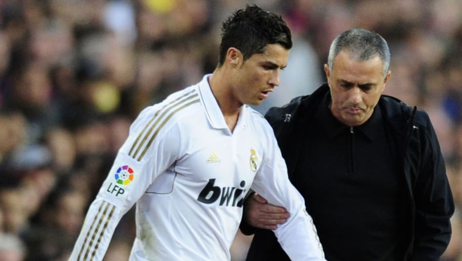 Real Madrid's Portuguese forward Cristiano Ronaldo (L) listens to with Real Madrid's Portuguese coach Jose Mourinho (R) during the Spanish League 'El clasico' football match Barcelona vs Real Madrid at the Camp Nou stadium in Barcelona on April 21, 2012.  AFP PHOTO/JAVIER SORIANO (Photo credit should read JAVIER SORIANO/AFP/Getty Images)