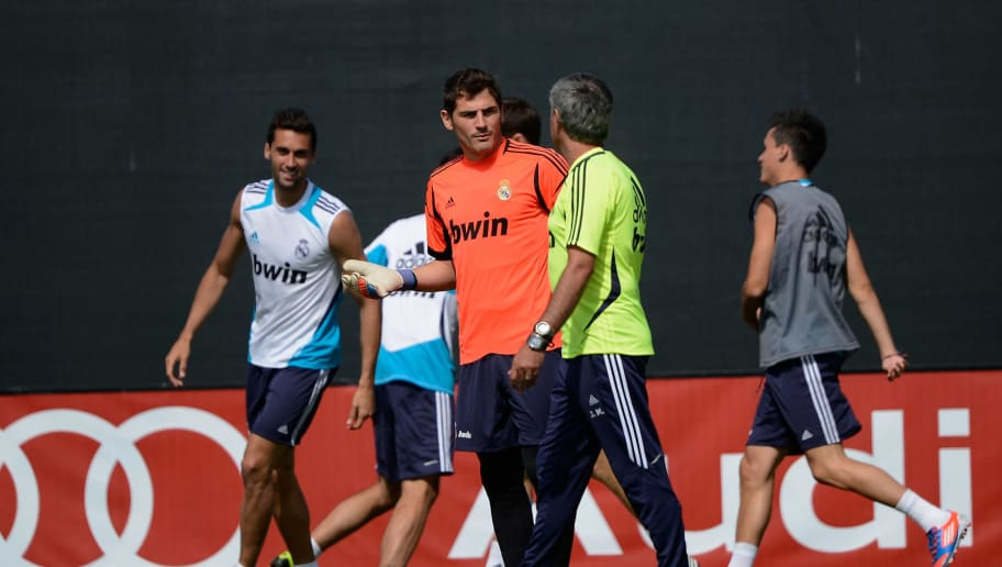 LOS ANGELES, CA - AUGUST 01:  Head coach Jose Mourinho (2nd R) of Real Madrid speaks with goalkeeper Iker Casillas during a training session  on the UCLA campus on August 1, 2012 in Los Angeles, California. Real Madrid will play a friendly soccer match against the Los Angeles Galaxy on August 2, at the Home Depot Center.  (Photo by Kevork Djansezian/Getty Images)