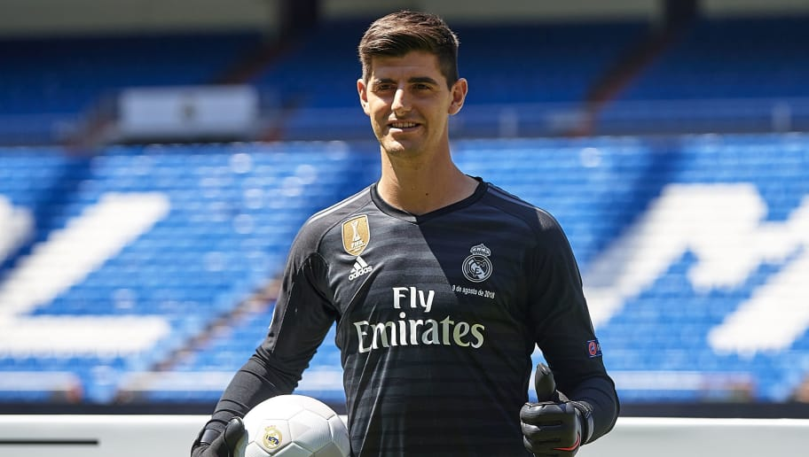 MADRID, SPAIN - AUGUST 09:  Thibaut Courtois poses on the pitch after being announced as a Real Madrid player during at Estadio Santiago Bernabeu on August 9, 2018 in Madrid, Spain. (Photo by Quality Sport Images/Getty Images)