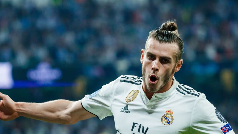 MADRID, SPAIN - SEPTEMBER 19: Gareth Bale of Real Madrid celebrates after scoring his team`s second goal during the UEFA Champions League Group G match between Real Madrid and AS Roma at Bernabeu on September 19, 2018 in Madrid, Spain. (Photo by TF-Images/Getty Images)