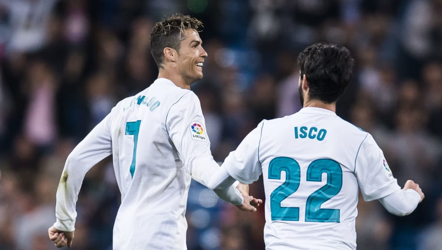 MADRID, SPAIN - APRIL 18: Cristiano Ronaldo of Real Madrid celebrates with teammate Isco Alarcon during the La Liga match between Real Madrid and Athletic Club at Estadio Santiago Bernabeu on April 18, 2018 in Madrid, Spain. (Photo by Power Sport Images/Getty Images)