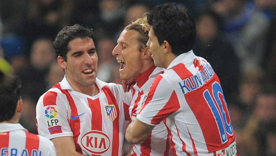 MADRID, SPAIN - JANUARY 13:  Diego Forlan (C) of Atletico celebrates with Alvaro Dominguez (L) and Sergio Aguero after scoring Atletico's first goal during the Copa del Rey quarter final first leg match between Real Madrid and Atletico Madrid at Estadio Santiago Bernabeu on January 13, 2011 in Madrid, Spain.  (Photo by Denis Doyle/Getty Images)