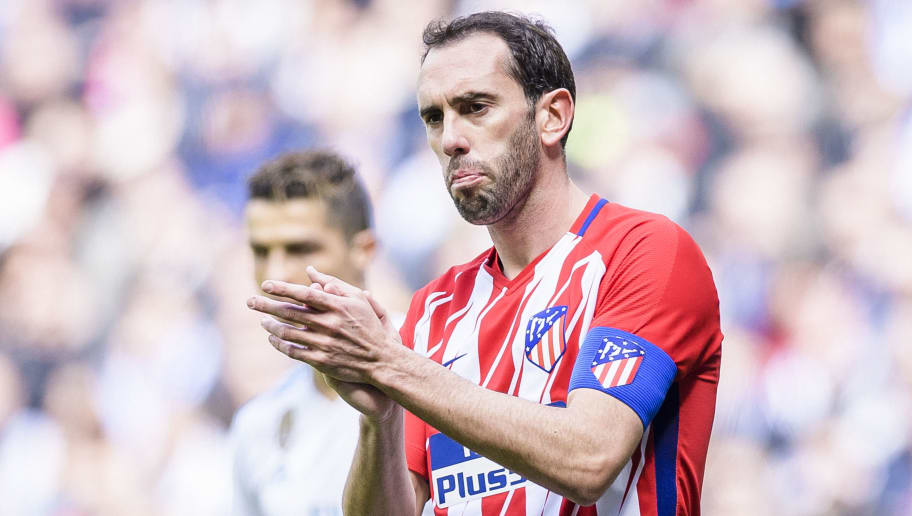 MADRID, SPAIN - APRIL 08: Diego Roberto Godin Leal of Atletico de Madrid gestures during the La Liga match between Real Madrid and Atletico Madrid at Estadio Santiago Bernabeu on April 8, 2018 in Madrid, Spain. (Photo by Power Sport Images/Getty Images)
