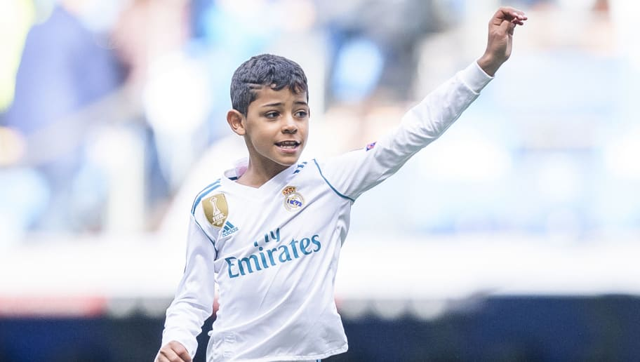 MADRID, SPAIN - APRIL 08: Cristiano Ronaldo Jr, son of Cristiano Ronaldo of Real Madrid, plays with a ball after the La Liga match between Real Madrid and Atletico Madrid at Estadio Santiago Bernabeu on April 8, 2018 in Madrid, Spain. (Photo by Power Sport Images/Getty Images)
