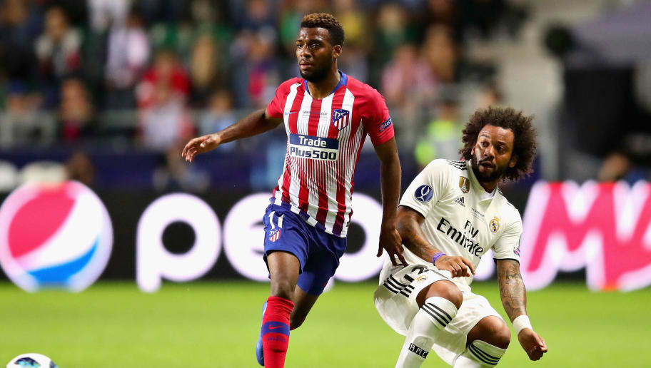 TALLINN, ESTONIA - AUGUST 15:  Marcelo of Real Madrid is challenged by Thomas Lemar of Atletico Madrid during the UEFA Super Cup between Real Madrid and Atletico Madrid at Lillekula Stadium on August 15, 2018 in Tallinn, Estonia.  (Photo by Chris Brunskill/Fantasista/Getty Images)