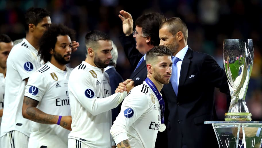 TALLINN, ESTONIA - AUGUST 15:  Sergio Ramos of Real Madrid looks dejected as he walks past the trophy following the UEFA Super Cup between Real Madrid and Atletico Madrid at Lillekula Stadium on August 15, 2018 in Tallinn, Estonia.  (Photo by Alexander Hassenstein/Getty Images)