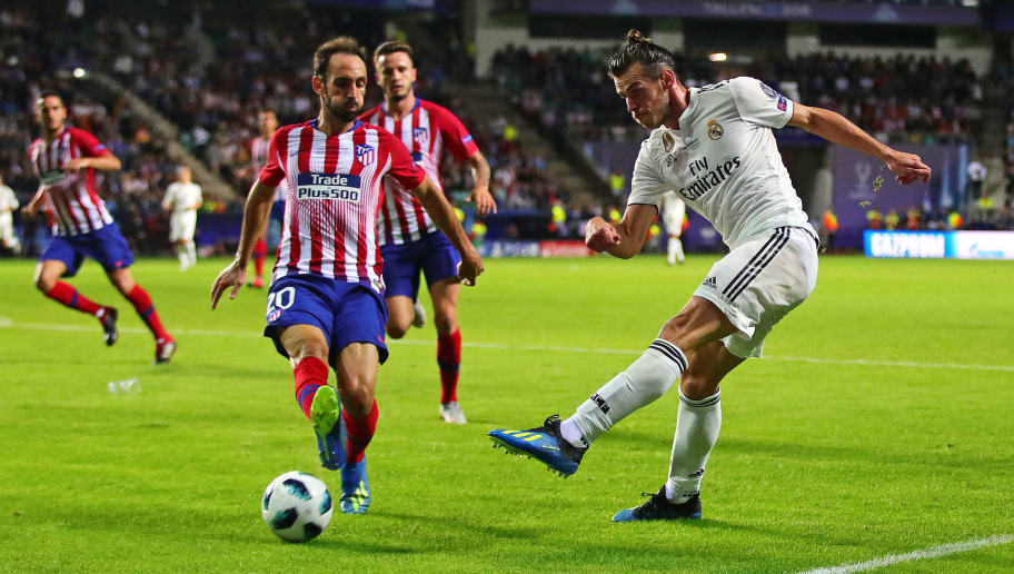 TALLINN, ESTONIA - AUGUST 15: Gareth Bale of Real Madrid shoots at goal under pressure from Juanfran of Atletico Madrid during the UEFA Super Cup between Real Madrid and Atletico Madrid at Lillekula Stadium on August 15, 2018 in Tallinn, Estonia. (Photo by Chris Brunskill/Fantasista/Getty Images)