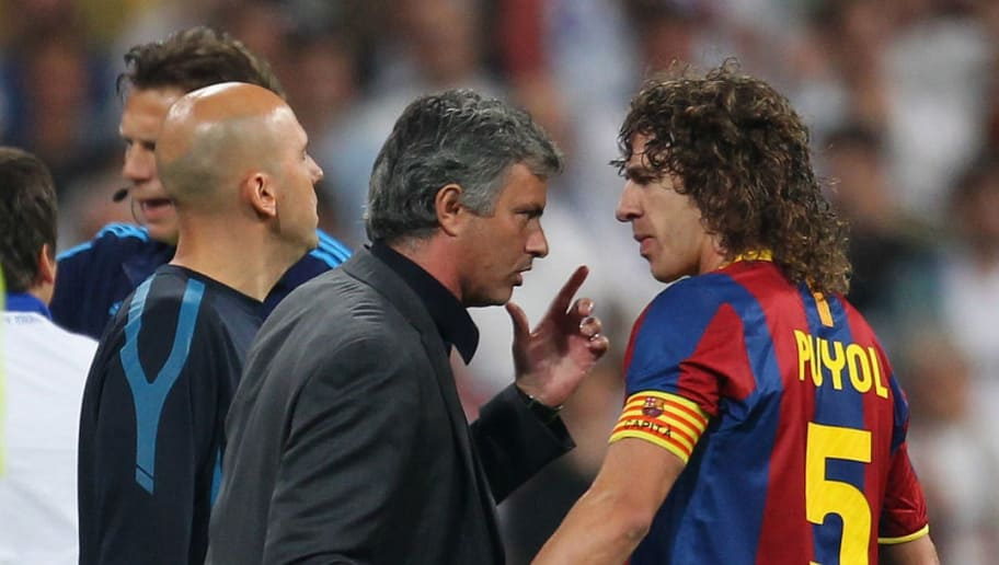 MADRID, SPAIN - APRIL 27:  Jose Mourinho of Real Madrid talks with Carles Puyol of Barcelona as Pepe of Real Madrid is sent off during the UEFA Champions League Semi Final first leg match between Real Madrid and Barcelona at Estadio Santiago Bernabeu on April 27, 2011 in Madrid, Spain.  (Photo by Alex Livesey/Getty Images)