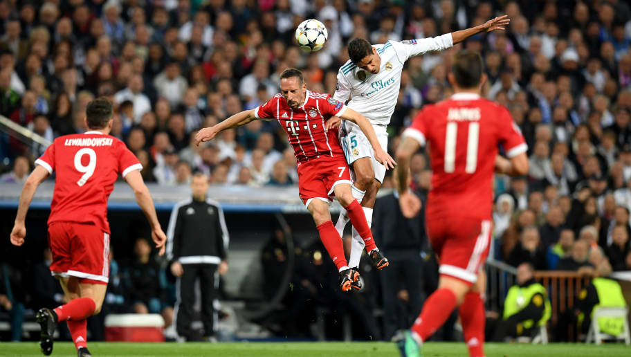 MADRID, SPAIN - MAY 01:  Raphael Varane of Real Madrid outjumps Franck Ribery of Bayern Muenchen  during the UEFA Champions League Semi Final Second Leg match between Real Madrid and Bayern Muenchen at the Bernabeu on May 1, 2018 in Madrid, Spain.  (Photo by Matthias Hangst/Bongarts/Getty Images)