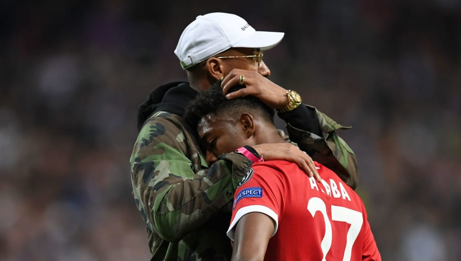 MADRID, SPAIN - MAY 01: Jerome Boateng of Bayern Muenchen embraces David Alaba of Bayern Muenchen after defeat during the UEFA Champions League Semi Final Second Leg match between Real Madrid and Bayern Muenchen at the Bernabeu on May 1, 2018 in Madrid, Spain.  (Photo by Matthias Hangst/Bongarts/Getty Images)