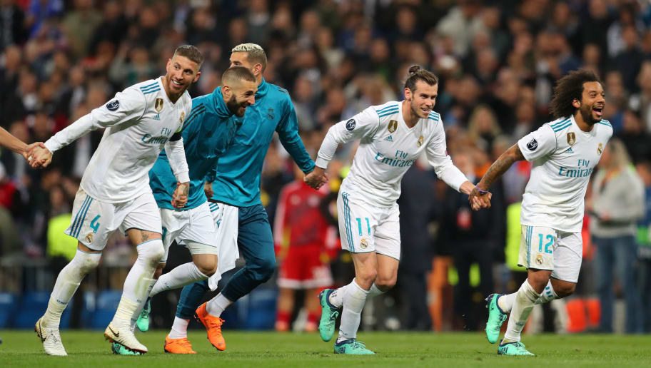 MADRID, SPAIN - MAY 01: Gareth Bale of Real Madrid celebrates with team mates after the UEFA Champions League Semi Final Second Leg match between Real Madrid and Bayern Muenchen at the Bernabeu on May 1, 2018 in Madrid, Spain. (Photo by Catherine Ivill/Getty Images)