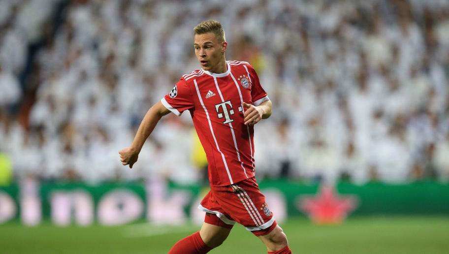MADRID, SPAIN - MAY 01: Joshua Kimmich of FC Bayern Muenchen controls the ball during the UEFA Champions League Semi Final Second Leg match between Real Madrid and Bayern Muenchen at the Bernabeu on May 1, 2018 in Madrid, Spain. (Photo by Matthias Hangst/Bongarts/Getty Images)