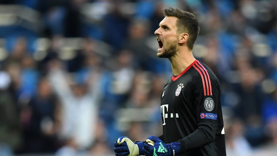 MADRID, SPAIN - MAY 01:  Sven Ulreich of Bayern Muenchen celebrates as  Joshua Kimmich of Bayern Muenchen scores his sides first goal during the UEFA Champions League Semi Final Second Leg match between Real Madrid and Bayern Muenchen at the Bernabeu on May 1, 2018 in Madrid, Spain.  (Photo by Matthias Hangst/Bongarts/Getty Images)