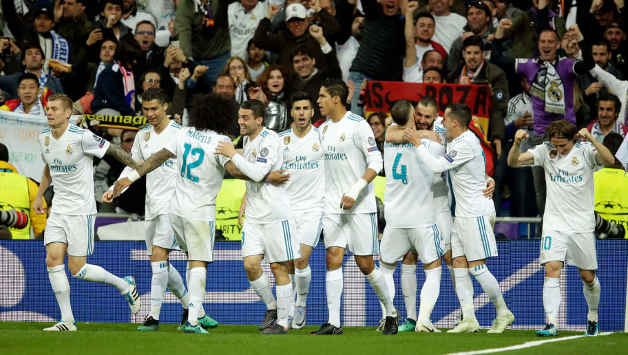 MADRID, SPAIN - MAY 1: Karim Benzema of Real Madrid celebrates 2-1 with Toni Kroos of Real Madrid, Cristiano Ronaldo of Real Madrid, Marcelo of Real Madrid, Mateo Kovacic of Real Madrid, Raphael Varane of Real Madrid, Sergio Ramos of Real Madrid, Lucas Vazquez of Real Madrid, Luka Modric of Real Madrid  during the UEFA Champions League  match between Real Madrid v Bayern Munchen at the Santiago Bernabeu on May 1, 2018 in Madrid Spain (Photo by Eric Verhoeven/Soccrates/Getty Images)