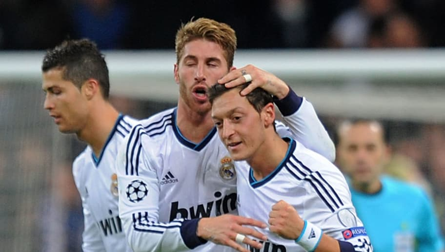 MADRID, SPAIN - NOVEMBER 06:  Mesut Ozil #10 of Real Madrid celebrates with Sergio Ramos after scoring Real's 2nd goal during the UEFA Champions League Group D match between Real Madrid and Borussia Dortmund at Estadio Santiago Bernabeu on November 6, 2012 in Madrid, Spain.  (Photo by Denis Doyle/Getty Images)