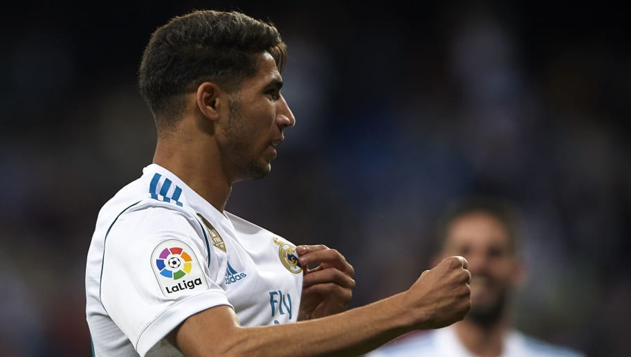 MADRID, SPAIN - MAY 12:  Achraf Hakimi of Real Madrid celebrates scoring his team's fourth goal during the La Liga match between Real Madrid and Celta de Vigo at Estadio Santiago Bernabeu on May 12, 2018 in Madrid, Spain.  (Photo by Quality Sport Images/Getty Images)