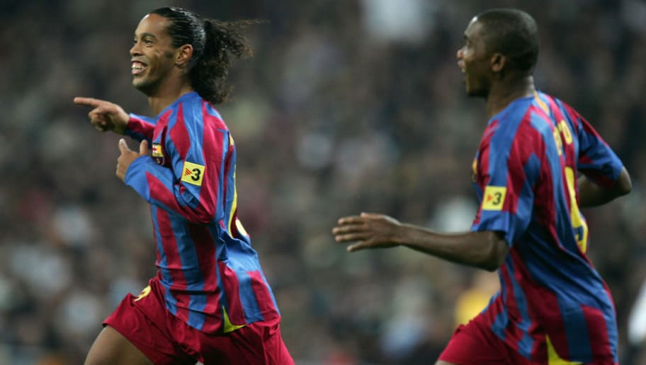 MADRID, SPAIN - NOVEMBER 19:  Ronaldinho (L) of Barcelona celebrates with Samuel Eto'o after scoring a goal during a Primera Liga match between Real Madrid and F.C. Barcelona at the Bernabeu on November 19, 2005 in Madrid, Spain.  (Photo by Denis Doyle/Getty Images)