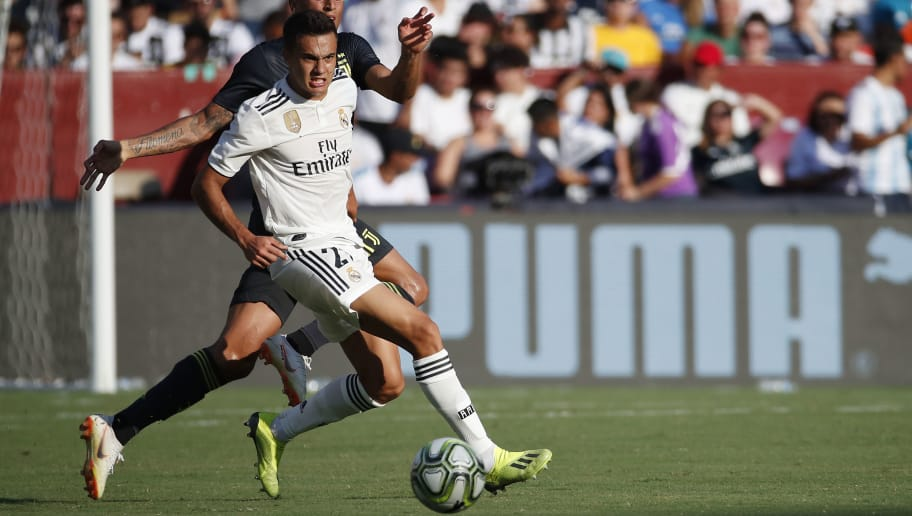 LANDOVER, MD - AUGUST 04: Sergio Reguilon #29 of Real Madrid and Joao Cancelo #20 of Juventus battle for the ball during the International Champions Cup 2018 at FedExField on August 4, 2018 in Landover, Maryland. (Photo by Patrick McDermott/Getty Images)