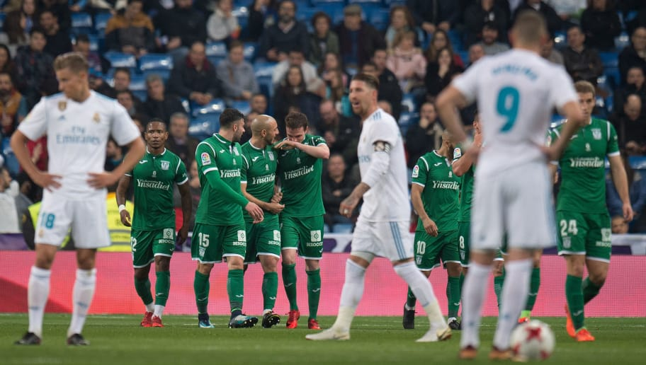 MADRID, SPAIN - JANUARY 24:  Leganes players celebrate after scoring their opening goal during the Copa del Rey, Quarter Final, Second Leg match between Real Madrid and Leganes at the Santiago Bernabeu stadium on January 24, 2018 in Madrid, Spain. (Photo by Denis Doyle/Getty Images)