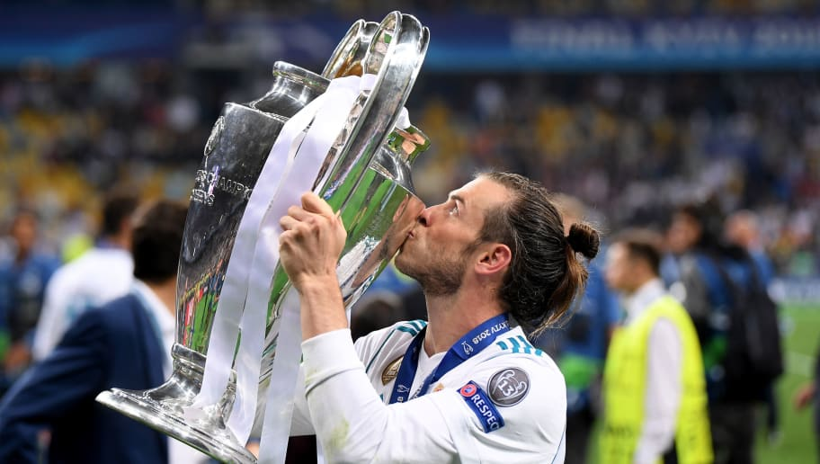 KIEV, UKRAINE - MAY 26:  Gareth Bale of Real Madrid kisses the UEFA Champions League Trophy following his sides victory in the UEFA Champions League Final between Real Madrid and Liverpool at NSC Olimpiyskiy Stadium on May 26, 2018 in Kiev, Ukraine.  (Photo by Laurence Griffiths/Getty Images)