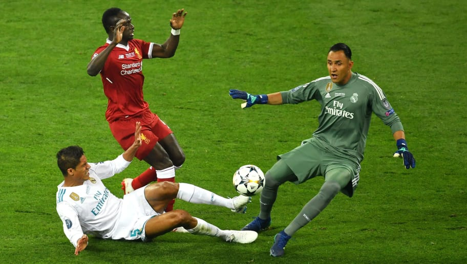KIEV, UKRAINE - MAY 26:  Raphael Varane of Real Madrid, collides with Sadio Mane of Liverpool and Keylor Navas of Real Madrid during the UEFA Champions League Final between Real Madrid and Liverpool at NSC Olimpiyskiy Stadium on May 26, 2018 in Kiev, Ukraine.  (Photo by Mike Hewitt/Getty Images)