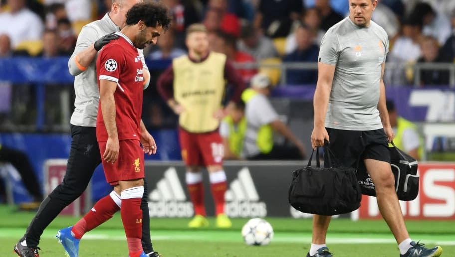 KIEV, UKRAINE - MAY 26:  Mohamed Salah of Liverpool reacts whilst leaving the pitch injured during the UEFA Champions League Final between Real Madrid and Liverpool at NSC Olimpiyskiy Stadium on May 26, 2018 in Kiev, Ukraine.  (Photo by Laurence Griffiths/Getty Images)