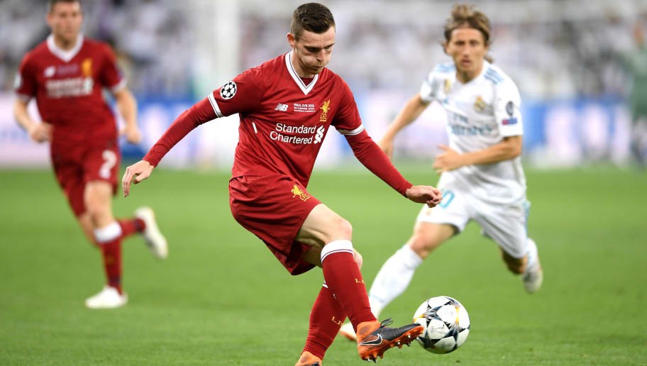 KIEV, UKRAINE - MAY 26: Andy Robertson of Liverpool is put under pressure by Luka Modric of Real Madrid during the UEFA Champions League Final between Real Madrid and Liverpool at NSC Olimpiyskiy Stadium on May 26, 2018 in Kiev, Ukraine.  (Photo by Laurence Griffiths/Getty Images)
