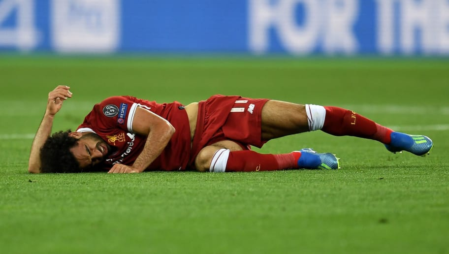 KIEV, UKRAINE - MAY 26:  Mohamed Salah of Liverpool goes down during the UEFA Champions League Final between Real Madrid and Liverpool at NSC Olimpiyskiy Stadium on May 26, 2018 in Kiev, Ukraine.  (Photo by David Ramos/Getty Images)