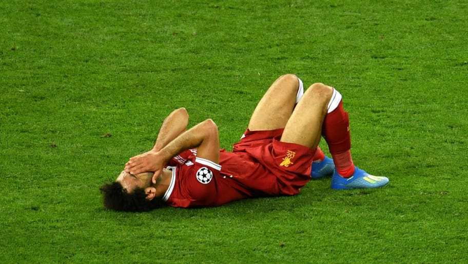 KIEV, UKRAINE - MAY 26:  Mohamed Salah of Liverpool reacts as he goes down injured during the UEFA Champions League Final between Real Madrid and Liverpool at NSC Olimpiyskiy Stadium on May 26, 2018 in Kiev, Ukraine.  (Photo by Mike Hewitt/Getty Images)
