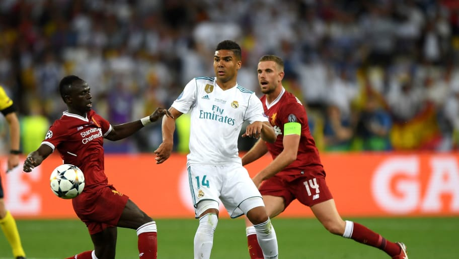KIEV, UKRAINE - MAY 26:  Casemiro of Real Madrid is challenged by Jordan Henderson and Sadio Mane of Liverpool during the UEFA Champions League Final between Real Madrid and Liverpool at NSC Olimpiyskiy Stadium on May 26, 2018 in Kiev, Ukraine.  (Photo by Shaun Botterill/Getty Images)