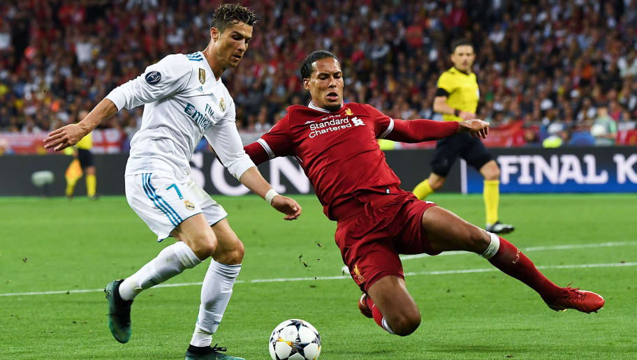 KIEV, UKRAINE - MAY 26:  Cristiano Ronaldo of Real Madrid CF competes for the ball with Virgil van Dijk of Leicester City FC during the UEFA Champions League final between Real Madrid and Liverpool on May 26, 2018 in Kiev, Ukraine.  (Photo by David Ramos/Getty Images)