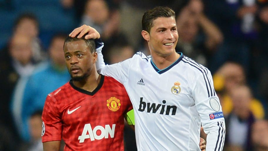 MADRID, SPAIN - FEBRUARY 13:  Patrice Evra of Manchester United and Cristiano Ronaldo of Real Madrid at the final whistle during the UEFA Champions League Round of 16 first leg match between Real Madrid and Manchester United at Estadio Santiago Bernabeu on February 13, 2013 in Madrid, Spain.  (Photo by Mike Hewitt/Getty Images)