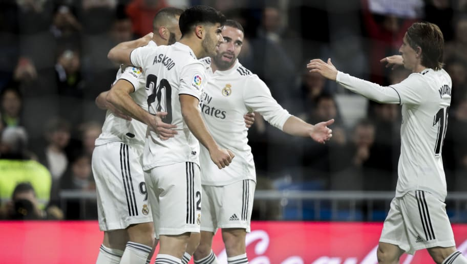 MADRID, SPAIN - DECEMBER 15: (L-R) Karim Benzema of Real Madrid, Marco Asensio of Real Madrid, Dani Carvajal of Real Madrid, Luka Modric of Real Madrid celebrate goal during the La Liga Santander  match between Real Madrid v Rayo Vallecano at the Santiago Bernabeu on December 15, 2018 in Madrid Spain (Photo by David S. Bustamante/Soccrates/Getty Images)