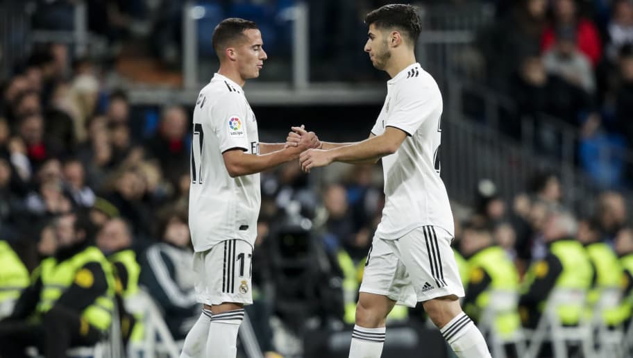 MADRID, SPAIN - DECEMBER 15: (L-R) Lucas Vazquez of Real Madrid, Marco Asensio of Real Madrid during the La Liga Santander  match between Real Madrid v Rayo Vallecano at the Santiago Bernabeu on December 15, 2018 in Madrid Spain (Photo by David S. Bustamante/Soccrates/Getty Images)