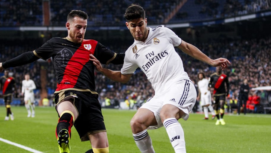 MADRID, SPAIN - DECEMBER 15: (L-R) Tito of Rayo Vallecano, Marco Asensio of Real Madrid during the La Liga Santander  match between Real Madrid v Rayo Vallecano at the Santiago Bernabeu on December 15, 2018 in Madrid Spain (Photo by David S. Bustamante/Soccrates/Getty Images)