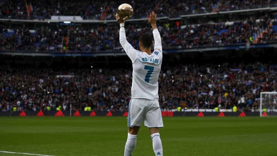 MADRID, SPAIN - DECEMBER 09: Cristiano Ronaldo of Real Madrid CF offers his fifth Golden Ball (Ballon d'Or) trophy to the audience prior to start the La Liga match between Real Madrid CF and Sevilla FC at Estadio Santiago Bernabeu on December 9, 2017 in Madrid, Spain . (Photo by Gonzalo Arroyo Moreno/Getty Images)