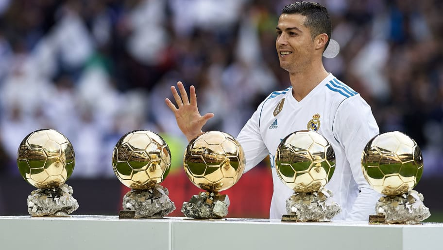 MADRID, SPAIN - DECEMBER 09:  Cristiano Ronaldo of Real Madrid poses for photographers with his 5 Balon d'Or awards prior to the La Liga match between Real Madrid and Sevilla at Estadio Santiago Bernabeu on December 9, 2017 in Madrid, Spain.  (Photo by fotopress/Getty Images)