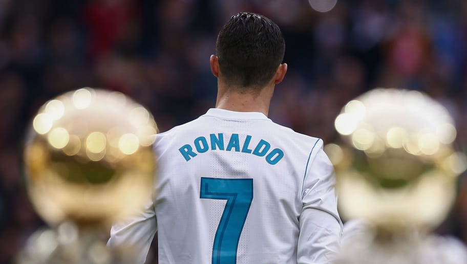 MADRID, SPAIN - DECEMBER 09: Cristiano Ronaldo of Real Madrid CF walks to the pitch after posing with his five Golden Ball (Ballon d'Or) trophies   prior to start the La Liga match between Real Madrid CF and Sevilla FC at Estadio Santiago Bernabeu on December 9, 2017 in Madrid, Spain . (Photo by Gonzalo Arroyo Moreno/Getty Images)