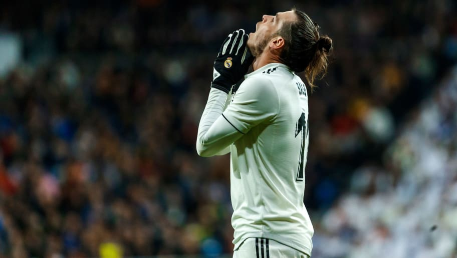 MADRID, SPAIN - DECEMBER 01: Gareth Bale of Real Madrid looks dejected during the La Liga match between Real Madrid v Valencia at the Santiago Bernabeu on December 1, 2018 in Madrid Spain. (Photo by TF-Images/TF-Images via Getty Images)